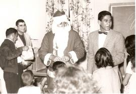 Santa at St. Henry's with children